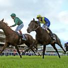 Decorated Knight (left) lands the Irish Champion Stakes