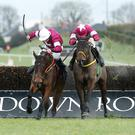 Close call: Sutton Manor, ridden by JJ Codd (left), beats Burgas, with Sean Flanagan on board, in the Irish Stallions Farms EBF Beginners Chase at Down Royal's big Boxing Day meeting
