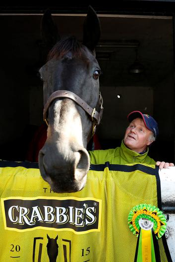 Champion: Crabbie's Grand National winner Many Clouds with stable lad CJ during a photocall held at trainer Oliver Sherwood's stables