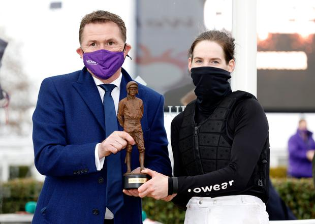 Rachael Blackmore is presented with the top jockey award by Sir AP McCoy