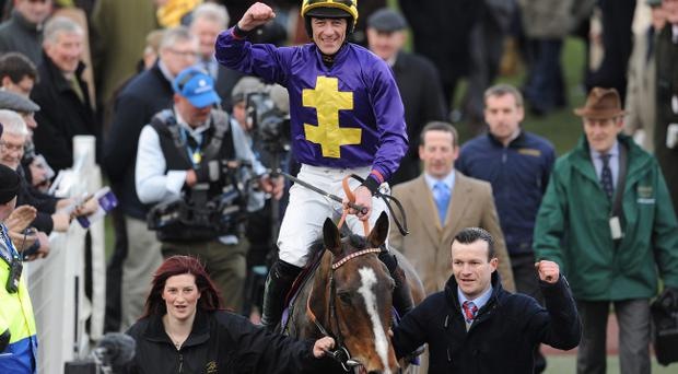 Davy Russell celebrates on Lord Windermere after winning the RSA Chase during Ladies Day at the 2013 Cheltenham Festival at Cheltenham Racecourse, Gloucestershire