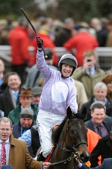 Paul Carberry celebrates on Solwhit after winning the Ladbrokes World Hurdle on St Patrick's Thursday of the 2013 Cheltenham Festival