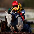 Up and over: Tony McCoy in action at Sandown yesterday