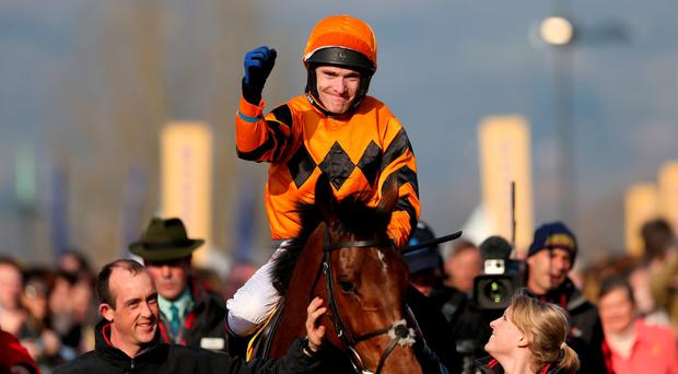 World first: Tom Scudamore after riding Thistlecrack to victory in the World Hurdle at Cheltenham yesterday
