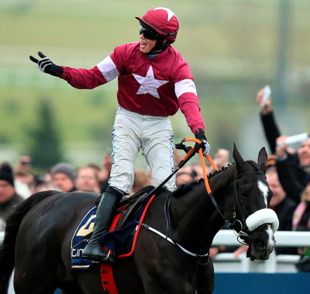 Star man: Bryan Cooper celebrates his Cheltenham Gold Cup triumph on Don Cossack