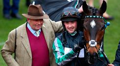 Triumph: Nicky Henderson and Nico de Boinville celebrate after winning the Betway Queen Mother Champion Chase with Altior