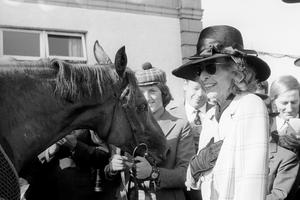 Lady Beaverbrook sees her racehorse Bustino being led in after winning the St Leger Stakes at Doncaster (PA)