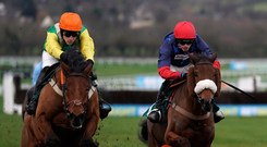 Night rider: Midnight Shadow (left), with Danny Cook on board, on the way to their previous victory at Cheltenham