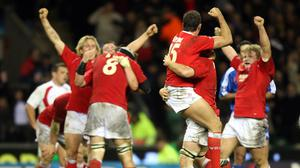 Wales players celebrate after beating England at Twickenham in 2008 (PA)