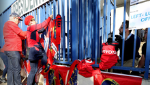 Tributes: Munster fans tie flags to the railings at Stade Yves-Du-Manoir In Paris after hearing of the death of coach Anthony Foley