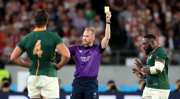 South Africa's Tendai Mtawarira (right) is shown a yellow card by referee Wayne Barnes.