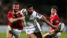 No room: Ulster's Charles Piutau is closed down by Jaco Taute
