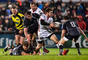 On the move: Ulster's Paddy Jackson in the thick of the action before injury brought his night to a premature end