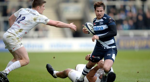 Sale Sharks' Danny Cipriani is tacked by Saracens' Maka Vunipola (right) and Owen Farrell (left) during the Pool One match of the European Rugby Champions Cup at the AJ Bell Stadium, Eccles.