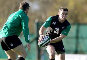 Gearing up: Darren Cave warms up for Ireland's clash with Georgia tomorrow