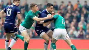 Sean Maitland is tackled by Garry Ringrose and Keith Earls