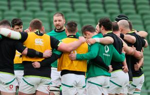 Centre of attention: Stand-in skipper Iain Henderson speaks to the Ireland players before the clash against France