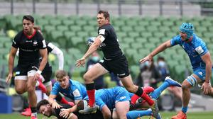 Saracens' Alex Goode, with ball in hand, on his way to scoring his first try.