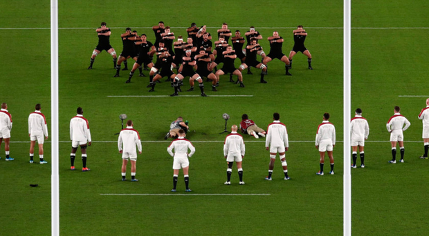 Defiance: England players confront the Haka
