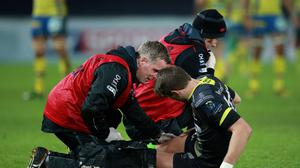 Dan Biggar receives treatment to his leg during the European Champions Cup match between Ospreys and Clermont