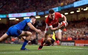 Josh Adams in try-scoring action for Wales (Adam Davy/PA)