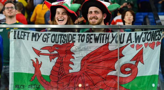 Wales fans at the World Cup. The young Welsh side has much to look forward to despite missing the final this time around, one of their coaches has said (Ashley Western/PA)