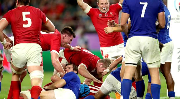 Wales' Ross Moriarty (bottom) scored the vital try as Wales beat France 20-19 in their Rugby World Cup quarter-final (David Davies/PA)
