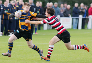 Holding off: Bangor's David Charles tries to break away from Ivan Jacob of Enniscorthy