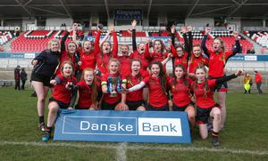 Royal Salute: Enniskillen Royal Grammar School captain India Daley celebrates with her team after defeating local rivals Erne Integrated College in the Ulster Schoolgirls' rugby final at Kingspan last month