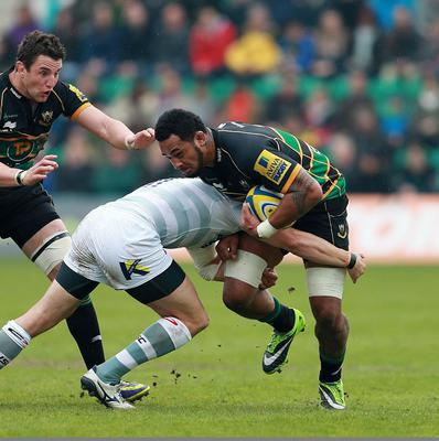 Northampton's Samu Manoa is tackled by London Irish's Andrew Fenby during the Aviva Premiership match at Franklins Gardens, Northampton.