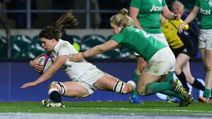 Abbie Scott, left, touches down for England's second try