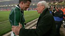 Legends meet: Jack Kyle congratulates Brian O'Driscoll after Ireland won the Grand Slam in Cardiff five years ago