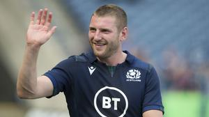 Finn Russell looks set to return to Scotland action (PA)