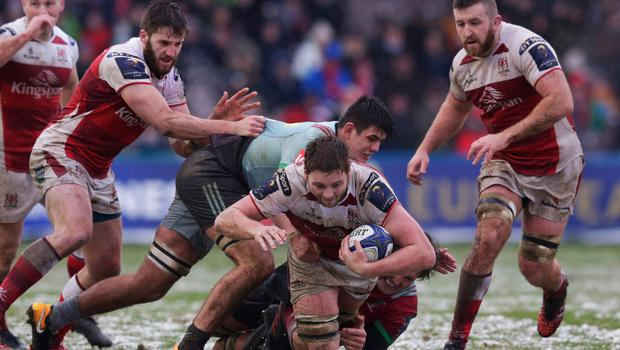 Close quarters: Iain Henderson is tackled by Archie White