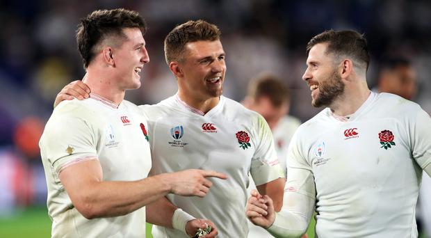 England's Tom Curry, Henry Slade and Elliot Daly celebrate after full-time (Adam Davy/PA)