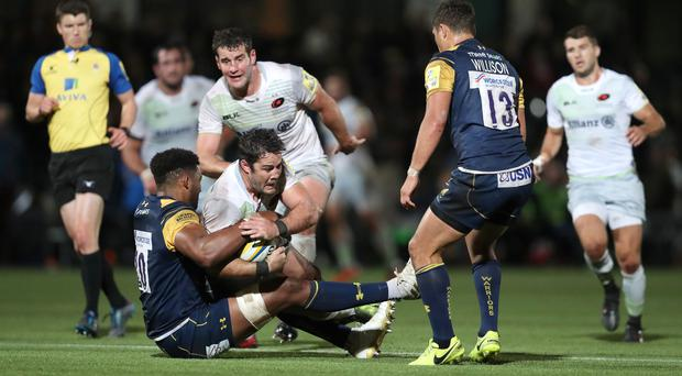 Christian Scotland-Williamson makes a tackle for Worcester against Saracens before he quit rugby in 2017 (David Davies/PA)