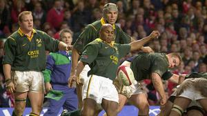 Former South Africa wing Chester Williams, centre, has died at the age of 49 (David Jones/PA).