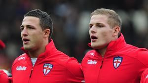 Sam Burgess, left, has been told not to rush to Bath after breaking his cheekbone in his last action for South Sydney