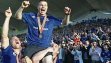 Just champion: Brian O'Driscoll of Leinster, in the last match of his career, is carried by Ian Madigan and Cian Healy after winning the Pro 12 trophy