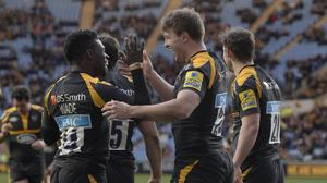 Wasps' Brendan Macken celebrates scoring his team's sixth try with Christian Wade (left).