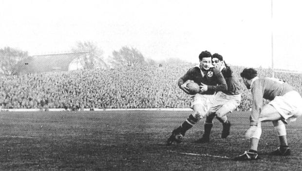 Watch him go: the late, great Jack Kyle sets off on one of his trademark mazy runs