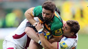 Ben Foden, pictured centre, was among the tryscorers as Northampton beat Treviso