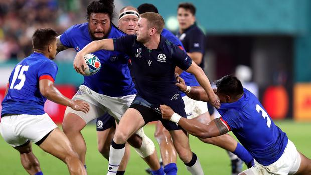 Scotland's Finn Russell, pictured in action against Samoa, will have to wait until after the England match to find out about his Scotland future.