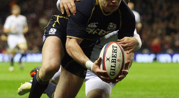 Stuart Hogg, pictured, set up Sean Maitland's opening try before adding a late one himself against England