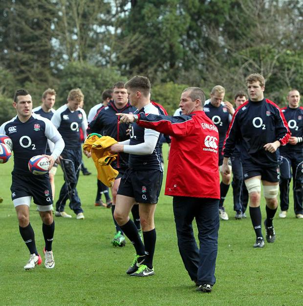 Stuart Lancaster, centre right, believes the Ireland game is a 'true test of our maturity'