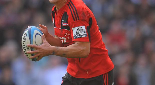 Dan Carter scored 11 points as the Crusaders beat the Bulls to claim their first victory of the Super Rugby season