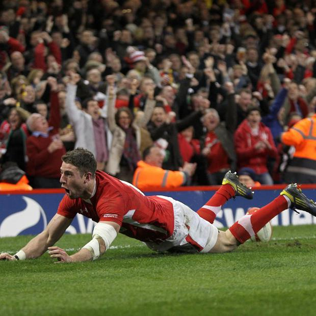 Alex Cuthbert celebrates scoring his first try against England