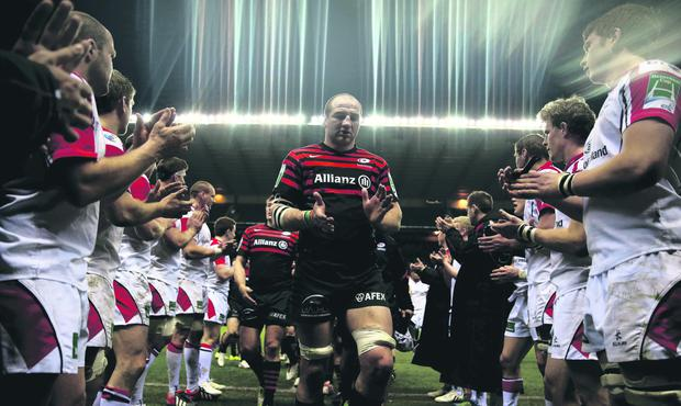 Saracens captain Steve Borthwick leads his team off the pitch following his team's victory during the Heineken Cup quarter final match between Saracens and Ulster at Twickenham Stadium on April 6, 2013 in London, England. (Photo by Warren Little/Getty Images)