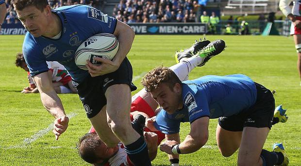 Brian O'Driscoll, centre, suffered a back spasm during the win over Glasgow