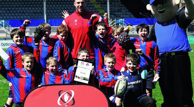 ©Press Eye Ltd Northern Ireland -14th May 2013 Domino's Pizza/Ulster Rugby Primary Schools' Festival at Ravenhill. Ulster Rugby star Stephen Ferris and Danny Domino with Moyallen Primary School, winners of the Fair Play award, at Tuesday's Dominos Pizza Ulster Rugby Primary Schools Festival at Ravenhill. Mandatory credit John McIlwaine/Press Eye